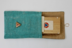 Small triptych made for an exhibition at the Bodleian Library, vellum 'pages', wooden panels and pouch made of silk and hand dyed linen.