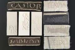 Woven, painted and embroidered names on a variety of surfaces. Panels approximately 7cm x 16cm.